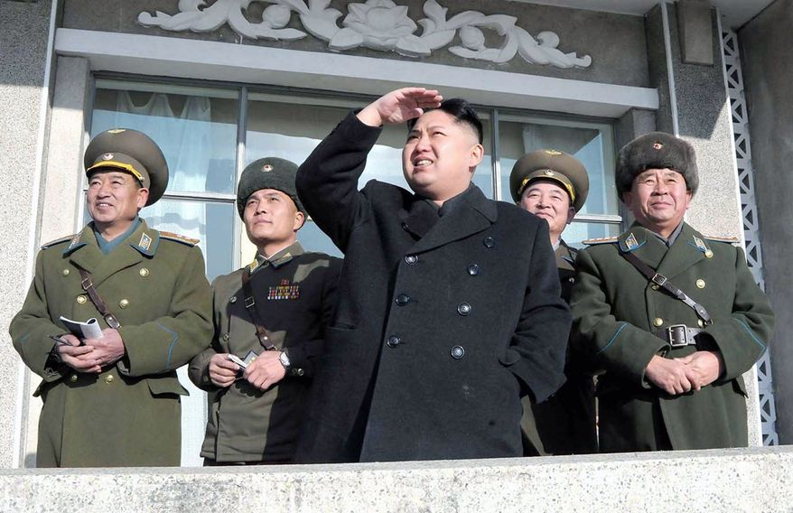 Flanked by military officers, Mr. Kim watches an air drill at an undisclosed air base in North Korea. Military photo-ops like this seek to show citizens that their new leader is firmly in command of the country's most important institution, its 1.2 million-strong military.