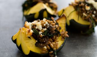 Farro-and-mushroom-stuffed acorn squash is a one-dish meal rich in savory flavors thanks to a blend of meat, mushrooms and cheese. Plenty of fiber ensures the dish is both substantial and healthy. (Associated Press)