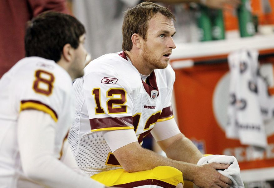 Washington Redskins quarterbacks Rex Grossman (8) and John Beck (12) sit on the bench during the second half of an NFLl game against the Buffalo Bills at the Rogers Centre in Toronto, Sunday, Oct. 30, 2011. (AP Photo/Derek Gee)