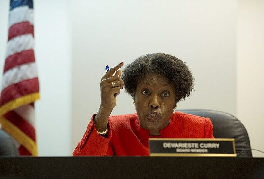 D.C. Board of Elections and Ethics member Devarieste Curry questions a witness during a hearing Thursday. Derek Ford (below, left) campaign treasurer for council member Yvette M. Alexander of Ward 7, confers with attorney David Wilmot during the hearing about allegations of violating the petition code of conduct in collecting signatures.