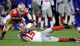 New York receiver Devin Thomas (15) had plenty of reason to celebrate after his two fumble recoveries - including this one in overtime - helped the Giants defeat the San Francisco 49ers. Thomas never found his niche in two-plus seasons with Washington. (Associated Press)