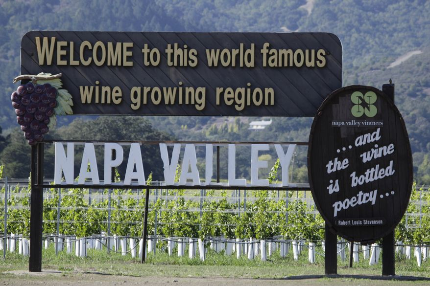 In this photo taken Oct. 27, 2011, a sign along Highway 29 welcomes visitors to the Napa Valley in Oakville, Calif. Napa Valley wine producers will go a long way to protect their good name, all the way to Thailand if necessary. (AP Photo/Eric Risberg)