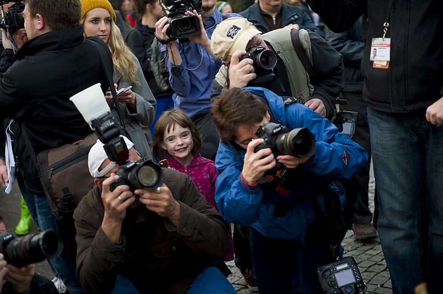 Ellen Lurie, 6, of Washington is sandwiched between news photographers and reporters during the inaugural Groundhog Day event at Dupont Circle in Washington on Thursday, Feb. 2, 2012. (Rod Lamkey Jr./The Washington Times)