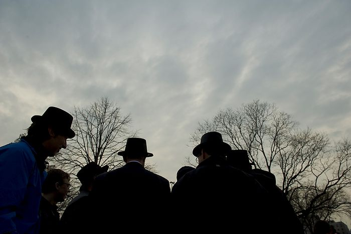Top-hatted men hosting the inaugural Groundhog Day event at Dupont Circle in Washington on Thursday, Feb. 2, 2012, are silhouetted against a rainy morning sky. (Rod Lamkey Jr./The Washington Times)