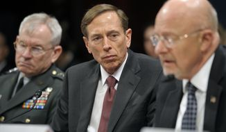 Army Lt. Gen. Ronald Burgess (left), Defense Intelligence Agency director; CIA Director David H. Petraeus (center); and James R. Clapper, director of national intelligence, testify on Capitol Hill in Washington on Thursday, Feb. 2, 2012, at a House Intelligence Committee hearing on worldwide threats. (AP Photo/Cliff Owen)
