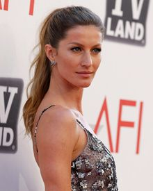 """Tom Brady's wife, Gisele Bundchen, is drumming up """"positive energy"""" for her husband in Sunday's Super Bowl. (Associated Press)"""