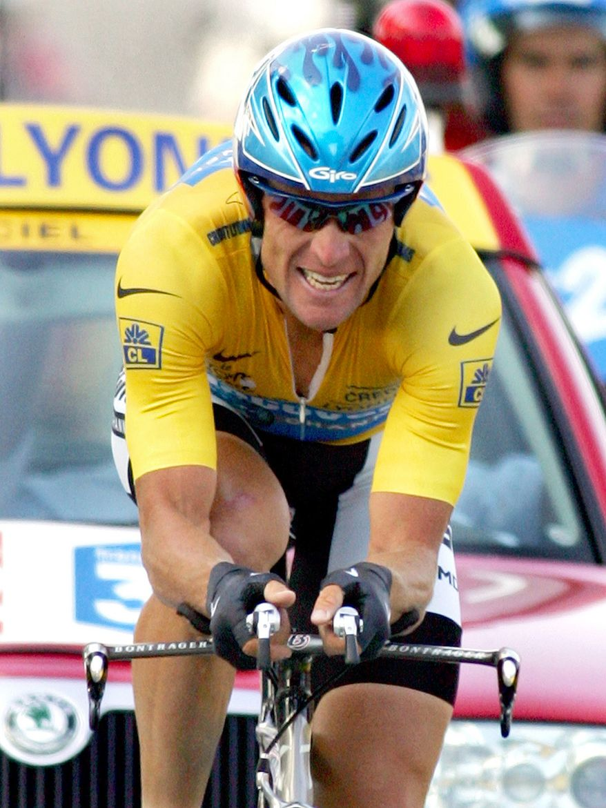 FILE - In this July 23, 2005 file photo, overall leader Lance Armstrong, of Austin, Texas, crosses the finish line to win the 20th stage of the Tour de France cycling race, a 55.5-kilometer (34.5-mile) individual time trial looping around north of Saint-Etienne, central France. Federal prosecutors said, Friday, Feb. 3, 2012, they are closing a criminal investigation of Armstrong and will not charge him over allegations the seven-time Tour de France winner used performance-enhancing drugs. (AP Photo/Alessandro Trovati, File)