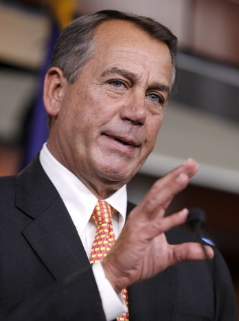 House Speaker John Boehner of Ohio gestures during a news conference on Capitol Hill in Washington, Thursday, Fe