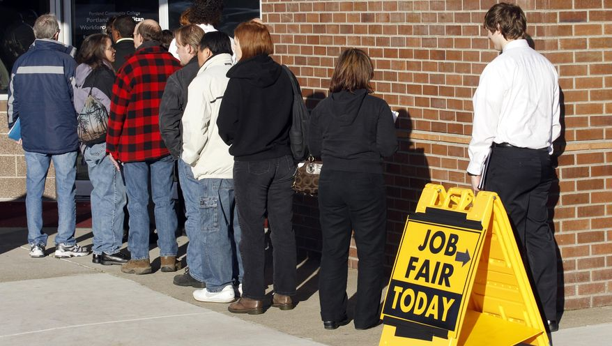 ** FILE ** This Jan. 12, 2012, photo shows people waiting in line at a job fair employer hiring event for Safeway in Portland, Ore. (AP Photo/Rick Bowmer)