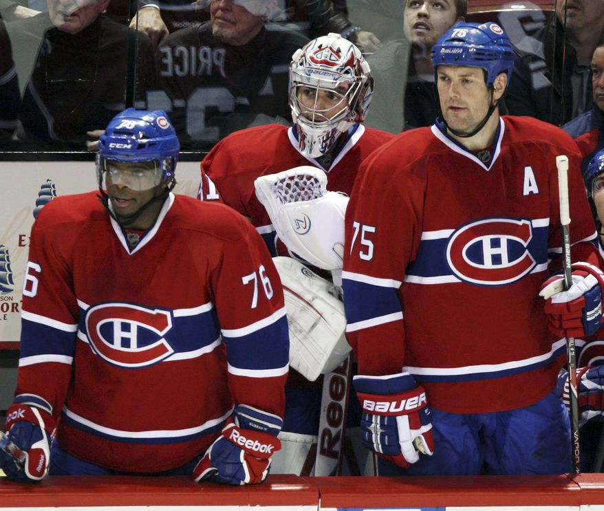 Montreal Canadiens' P.K. Subban, left, Carey Price and Hal Gill, right, watch the final minute of a 3-1 loss against the Buffalo Sabres, Tuesday, Jan. 31, 2012, in Montreal. (AP Photo/The Canadian Press, Ryan Remiorz)