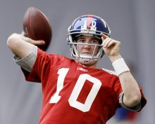 New York Giants' Eli Manning throws during practice, Friday, Feb. 3, 2012, in Indianapolis. The Giants will face the New England Patriots in the NFL football Super Bowl XLVI on Feb. 5.(AP Photo/Eric Gay)