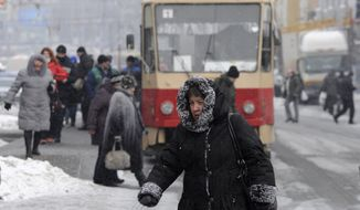 A pedestrian walks Feb. 3, 2012, on a street in Kiev. (Associated Press)