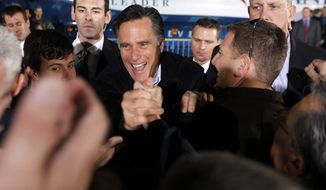 Republican presidential candidate, former Massachusetts Gov. Mitt Romney, greets supporters at a campaign rally in Henderson, Nev., Friday, Feb. 3, 2012. (AP Photo/Gerald Herbert)