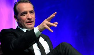 "Controversy over racy ads featuring Oscar-nominated actor Jean Dujardin for the new movie ""Les Infideles"" have some French newspapers wondering if it could cost him the award for his role in the hit silent film ""The Artist."" (Associated Press)"