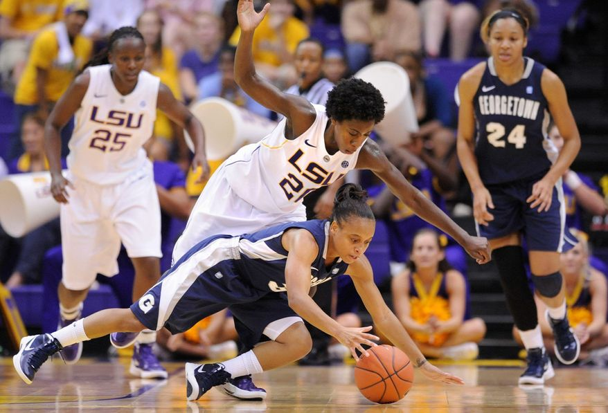 Point guard Rubylee Wright, hitting the floor in a game against LSU, holds Georgetown's career record for assists. She's averaging 4.7 per game. (Associated Press)
