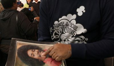 "Tyrone Proctor points to a picture of himself from the time when he was a ""Soul Train"" dancer. He attended a tribute to the show's creator, Don Cornelius, at the Rev. Al Sharpton's National Action Network in New York on Saturday. (Associated Press)"