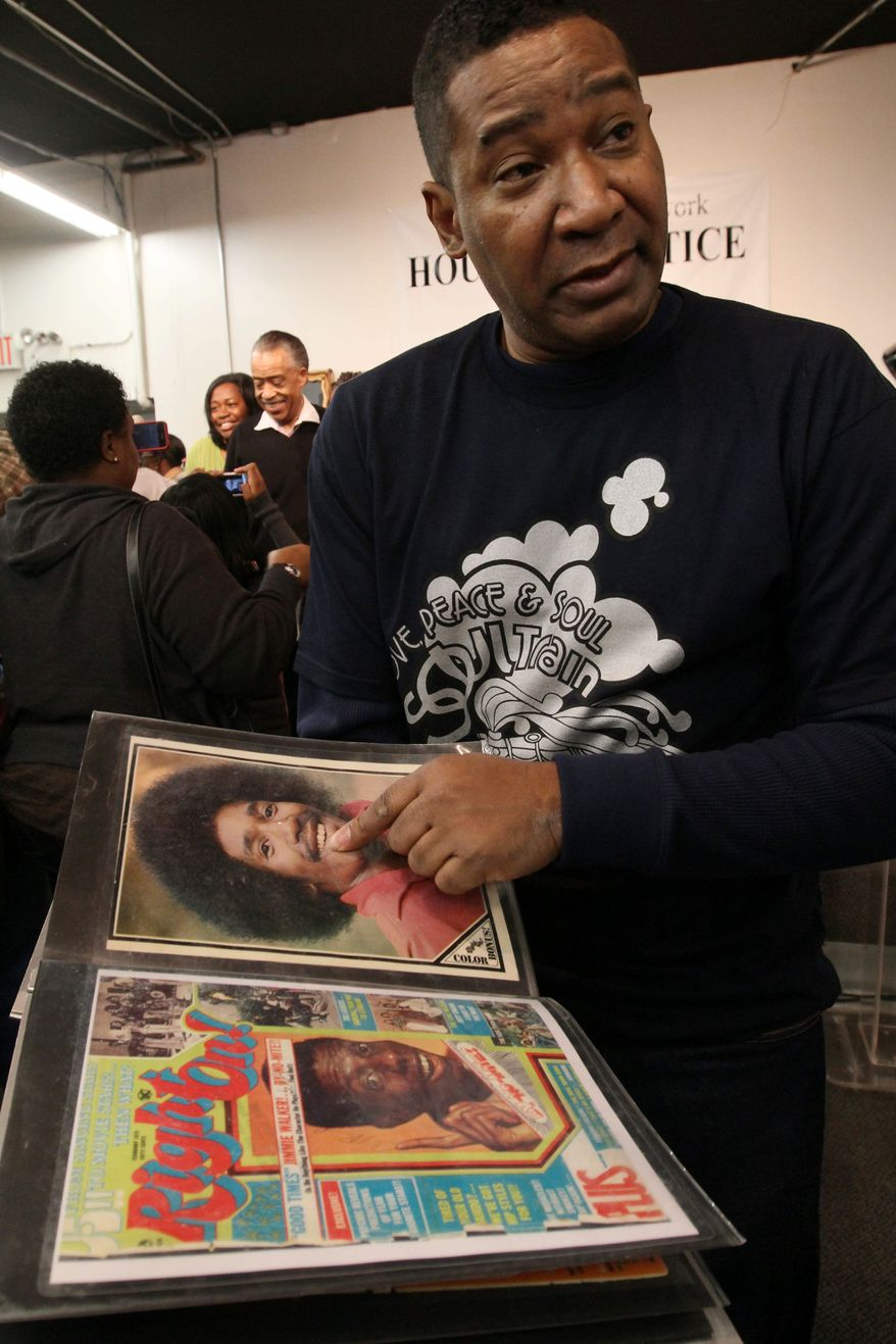 """Tyrone Proctor points to a picture of himself from the time when he was a """"Soul Train"""" dancer. He attended a tribute to the show's creator, Don Cornelius, at the Rev. Al Sharpton's National Action Network in New York on Saturday. (Associated Press)"""