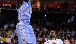 North Carolina forward Harrison Barnes (40) dunks over Maryland guard Sean Mosley (14) during the first half of an NCAA college basketball game, Saturday, Feb. 4, 2012, in College Park, Md. (AP Photo/Nick Wass)
