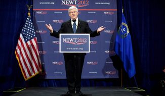 Newt Gingrich reiterates in Las Vegas that he is the true GOP conservative in the presidential race. (Associated Press)
