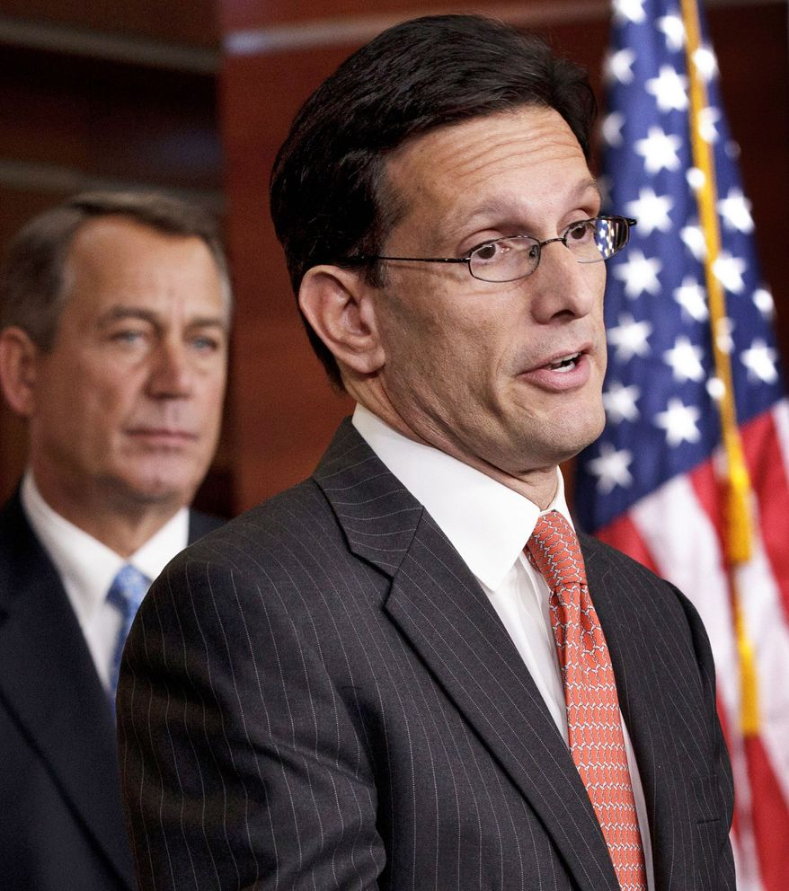 House Majority Leader Eric Cantor, Virginia Republican (right), promises to take swift action on the Stop Trading on Congressional Knowledge Act. He prefers the Senate bill over a narrower House version. Both bills explicitly ban insider trading. At left is House Speaker John A. Boehner, Ohio Republican. (Associated Press)