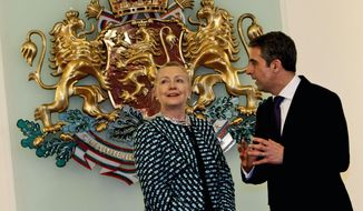 ** FILE ** U.S. Secretary of State Hillary Rodham Clinton talks with Bulgarian President Rosen Plevneliev before their meeting at the Bulgarian Presidency building in Sofia, Bulgaria, on Sunday, Feb. 5, 2012. (AP Photo/Oleg Popov)