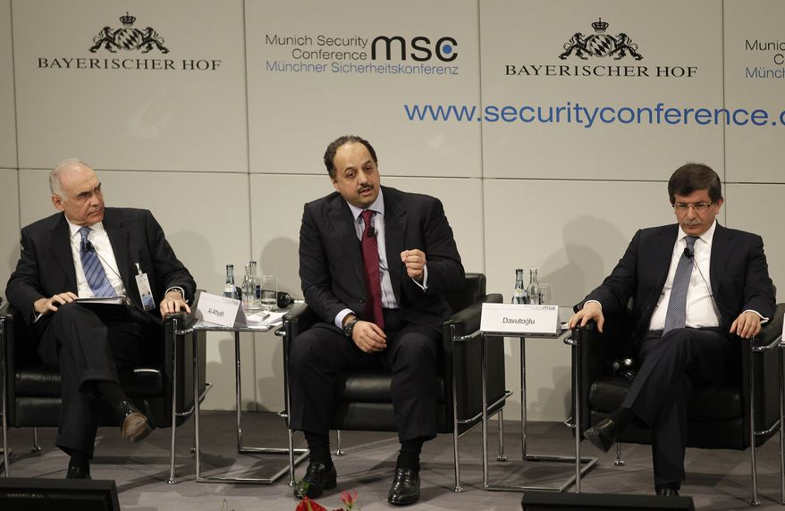 Turkish Foreign Minister Ahmet Davutoglu (right), Qatar Foreign Minister Khalid Mohamed A. Al-Attiyah (center) and Egyptian Foreign Minister Mohamed K. Amr participate in a panel discussion at the Conference on Security Policy on Sunday, Feb. 5, 2012 in Munich. (AP Photo/Frank Augstein)