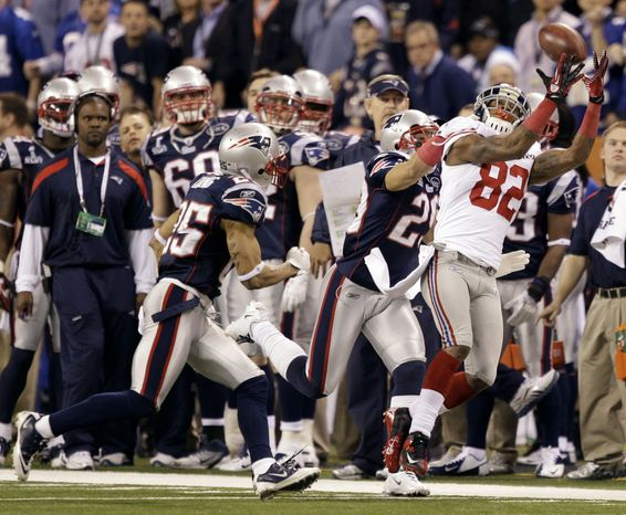 New York Giants wide receiver Mario Manningham catches a 38-yard fourth-quarter pass on the go-ahead drive that gave the Giants the ultimate 21-17 win over the New England Patriots in Super Bowl XLVI on Sunday, Feb. 5, 2012, in Indianapolis. (AP Photo/Marcio Jose Sanchez)