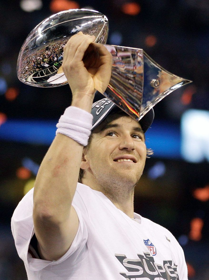 New York Giants quarterback Eli Manning holds up the Vince Lombardi Trophy while celebrating his team's 21-17 win over the New England Patriots in Super Bowl XLVI Sunday, Feb. 5, 2012, in Indianapolis. (Associated Press)