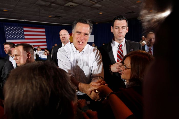 Republican presidential hopeful Mitt Romney greets supporters Monday at a rally in Grand Junction, Colo. Though favored to win Colorado's caucuses, the former Massachusetts governor is taking nothing for granted, with a fundraiser planned in Cherry Hills Village and rally set for Centennial. (Associated Press)