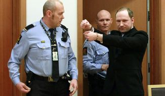Anders Behring Breivik (right), a right-wing Norwegian extremist who has confessed to a bombing and mass shooting that killed 77 people in July 2011, gestures as he arrives for a detention hearing at a court in Oslo on Monday, Feb. 6, 2012. (AP Photo/Heiko Junge, Scanpix Norway)