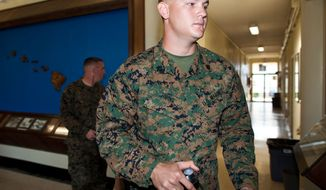 ** FILE ** Marine Sgt. Benjamin Johns walks to a courtroom at the Legal Services Center at Marine Corps Base Hawaii in Kaneohe Bay, Hawaii, on Monday, Jan. 30, 2012. (AP Photo/Kent Nishimura, File)