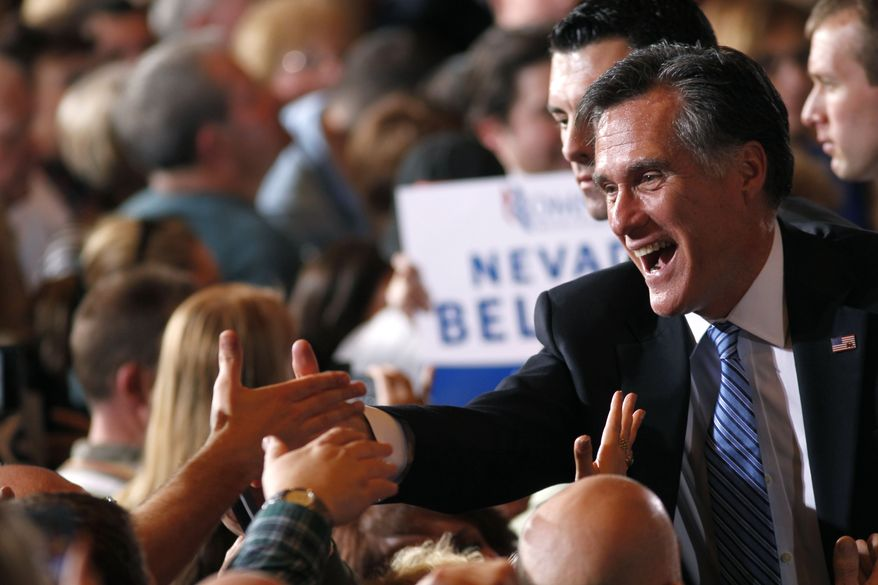 Republican presidential candidate and former Massachusetts Gov. Mitt Romney greets supporters Feb. 4, 2012, at his Nevada caucus night victory celebration in Las Vegas. (Associated Press)