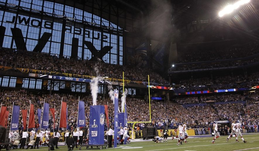 New York Giants players run onto the field before the NFL Super Bowl XLVI football game against the New England Patriots Sunday, Feb. 5, 2012, in Indianapolis. (AP Photo/David J. Phillip)