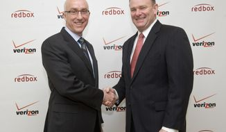 Bob Mudge (right), president of Verizon Consumer and Mass Business Markets, and Paul Davis, CEO of Coinstar Inc., announce a joint video-streaming venture in New York on Monday, Feb. 6, 2011. (Diane Bondareff/AP Images for Redbox)