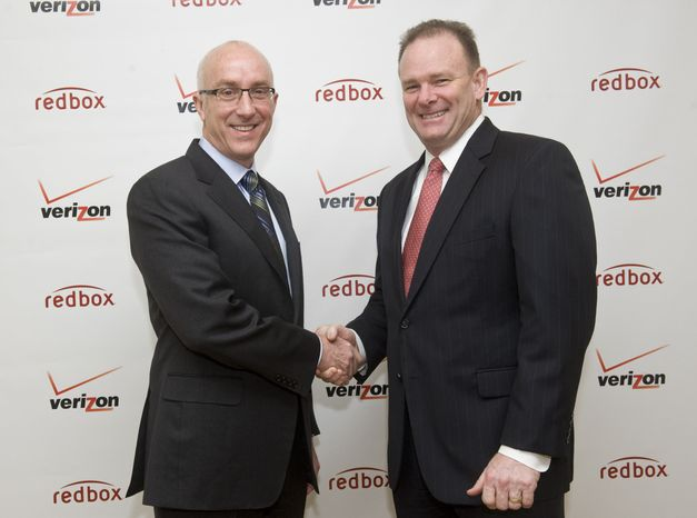 Bob Mudge (right), president of Verizon Consumer and Mass Business Markets, and Paul Davis, CEO of Coinstar Inc., announce a joint video-streaming venture i