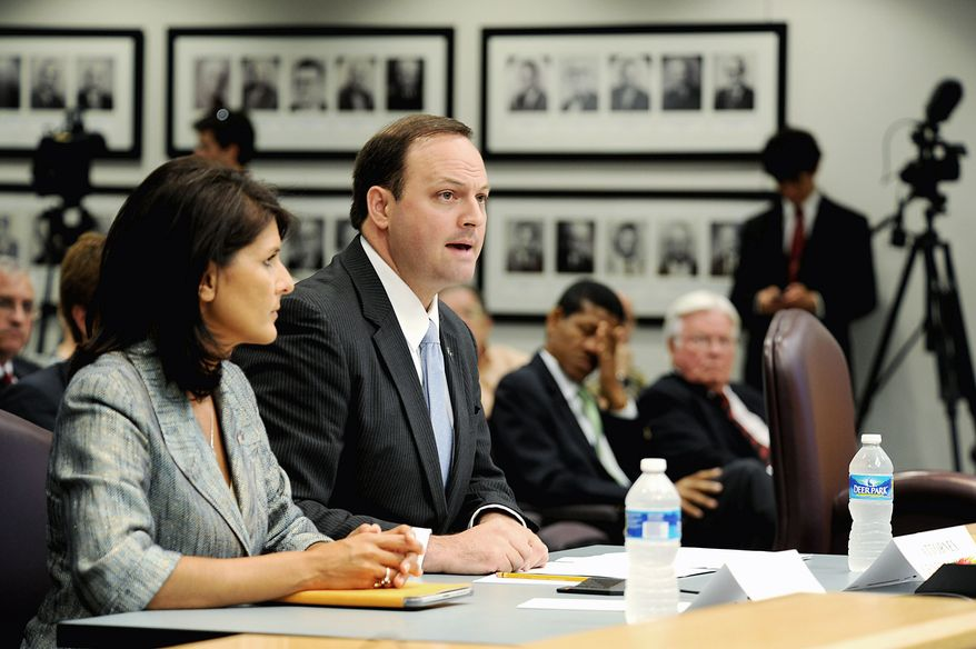 "** FILE ** South Carolina Attorney General Alan Wilson, here with Gov. Nikki Haley in June, argues in a lawsuit filed in February that the U.S. Justice Department erred in blocking the state from requiring voters to show government-issued photo identification to vote. The requirement ""will not disenfranchise any potential South Carolina voter,"" he said. (Jeremy Lock/Special to The Washington Times)"