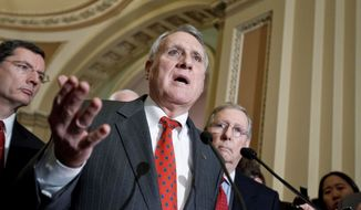 Senate Minority Whip Jon Kyl of Arizona, accompanied by fellow Republicans Sen. John Barrasso of Wyoming (left) and Senate Minority Leader Mitch McConnell of Kentucky (right), criticizes Democrats on the deadlocked bipartisan payroll-tax conference panel Tuesday at a news conference. (Associated Press)