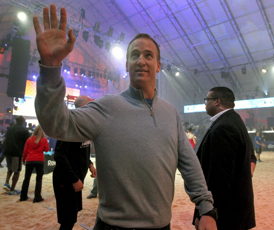 **FILE** Indianapolis Colts quarterback Peyton Manning waves to the crowd as he arrives Feb. 4, 2012, for the Celebrity Beach Bowl, part of NFL football's Super Bowl XLVI festivities in Indianapolis. (Associated Press)