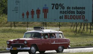 "** FILE ** A billboard in Havana in 2006 reads in English: ""70 percent of Cubans have been born under the embargo."" The U.S. economic embargo on communist-run Cuba turns 50 on Tuesday, Feb. 7, 2012. (AP Photo/Javier Galeano, File)"