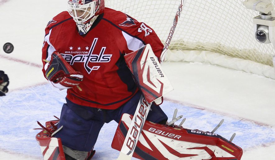 ** FILE ** Washington Capitals goalie Tomas Vokoun, of the Czech Republic, eyes the puck on a Florida Panthers during the first period of an NHL game Tuesday, Feb. 7, 2012, in Washington. The Capitals won 4-0. (AP Photo/Haraz N. Ghanbari)