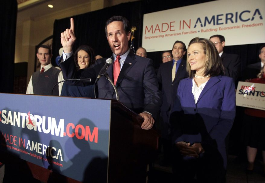Republican presidential candidate and former Pennsylvania Sen. Rick Santorum speaks Feb. 7, 2012, as his wife Karen (right) listens during a primary night watch party in St. Charles, Mo. (Associated Press)