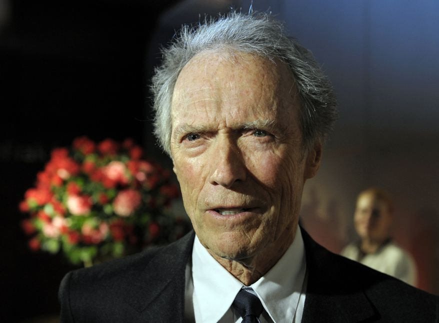Actor and director Clint Eastwood speaks with reporters at the opening of the Warner Bros. Theater at the Smithsonian Institution's National Museum of American History in Washington on Wednesday, Feb. 1, 2012. (AP Photo/Cliff Owen)
