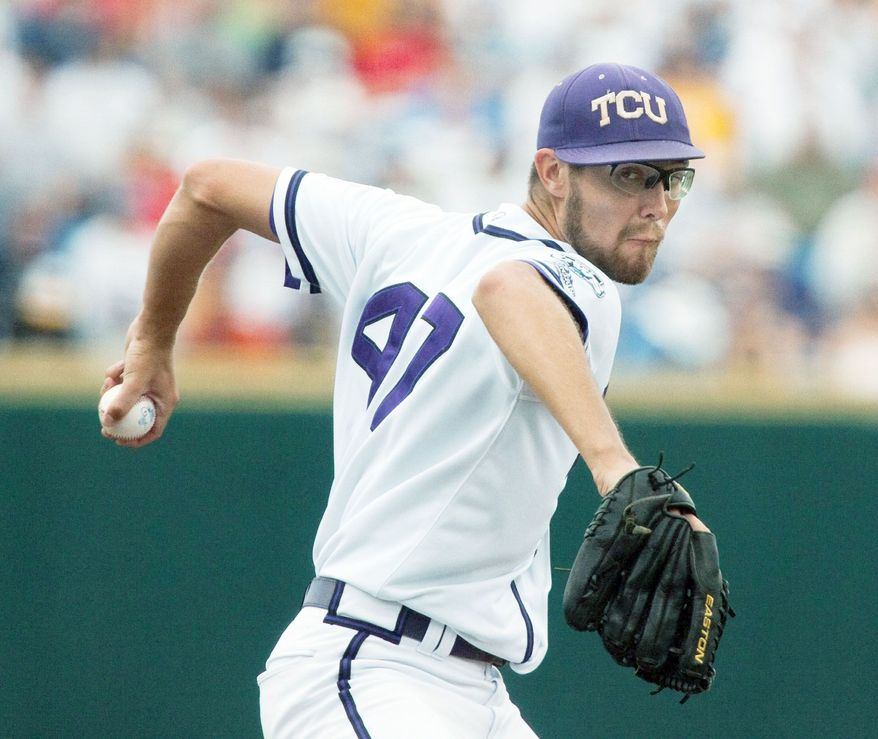 TCU starting pitcher Matt Purke winds up for a delivery against Florida State in the first inning of the opening baseball game of the NCAA College World Series, in Omaha, Neb., Saturday, June 19, 2010.(AP Photo/Nati Harnik)