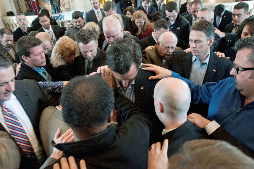 Former Sen. Rick Santorum of Pennsylvania, a Republican presidential candidate, is prayed over after speaking at the Bella Donna Chapel in McKinney, Texas, on Wednesday. Mr. Santorum won Republican caucuses in Minnesota and Colorado and a nonbinding primary in Missouri on Tuesday. (Associated Press)