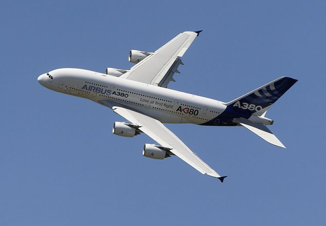 An Airbus A380 performs during a demonstration flight at the 49th Paris Air Show at Le Bourget Airport outside Paris on Sunday, June 26, 2011. (AP Photo/Francois Mori)