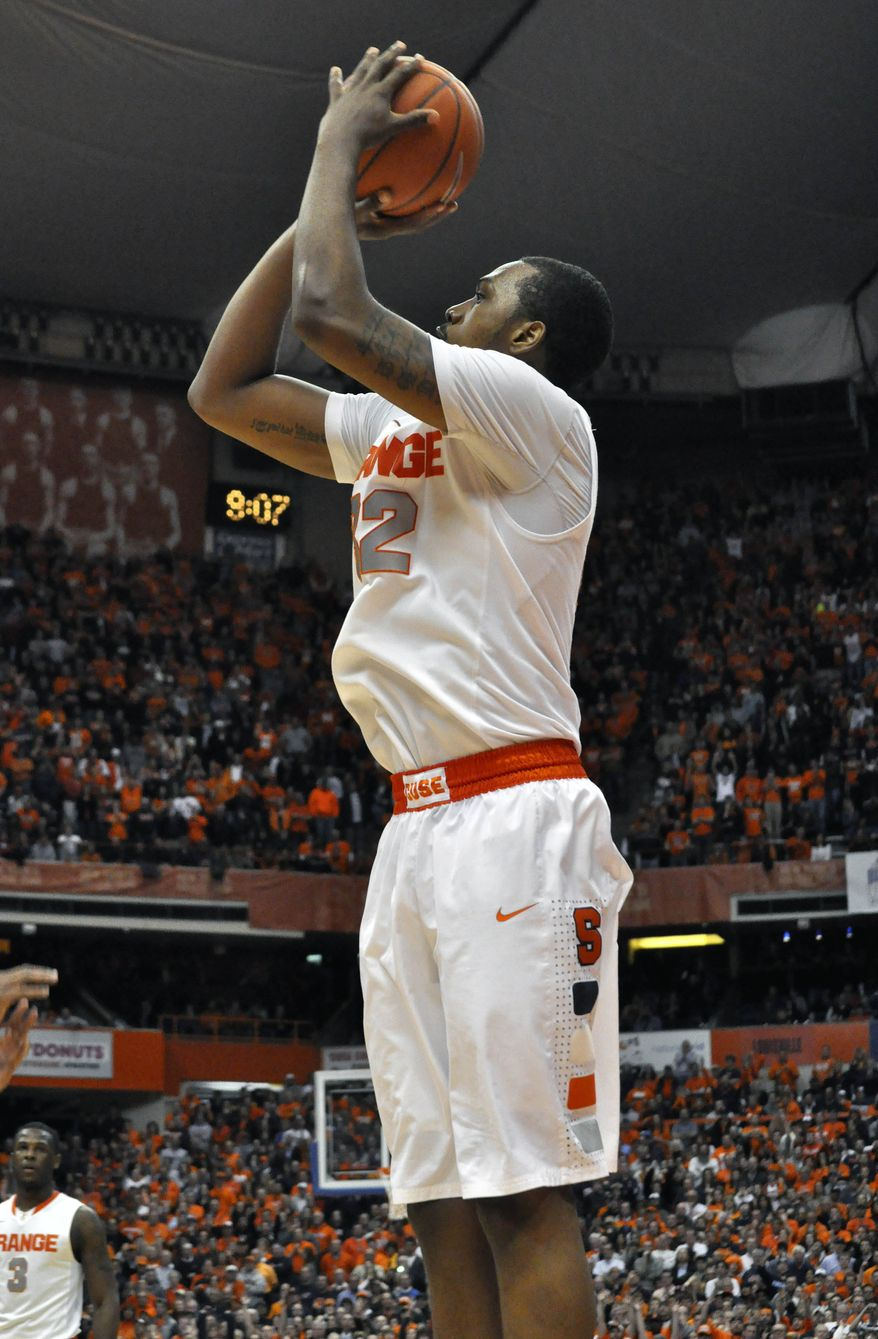 Syracuse's Kris Joseph hits what proves to be the game-winning basket with 29 seconds left in overtime against Georgetown in an NCAA basketball game in Syracuse, N.Y., Wednesday, Feb. 8, 2012. Syracuse won 64-61. (AP Photo/Kevin Rivoli)