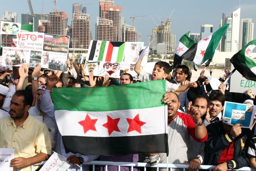 Syrians gather Feb. 8, 2012, in Doha to protest the use of Russia's veto against the amended resolution on Syria in the U.N. Security Council. (Associated Press)