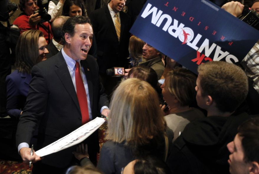 Republican presidential candidate and former Pennsylvania Sen. Rick Santorum greets supporters Feb. 7, 2012, after speaking at a primary night watch party in St. Charles, Mo. (Associated Press)