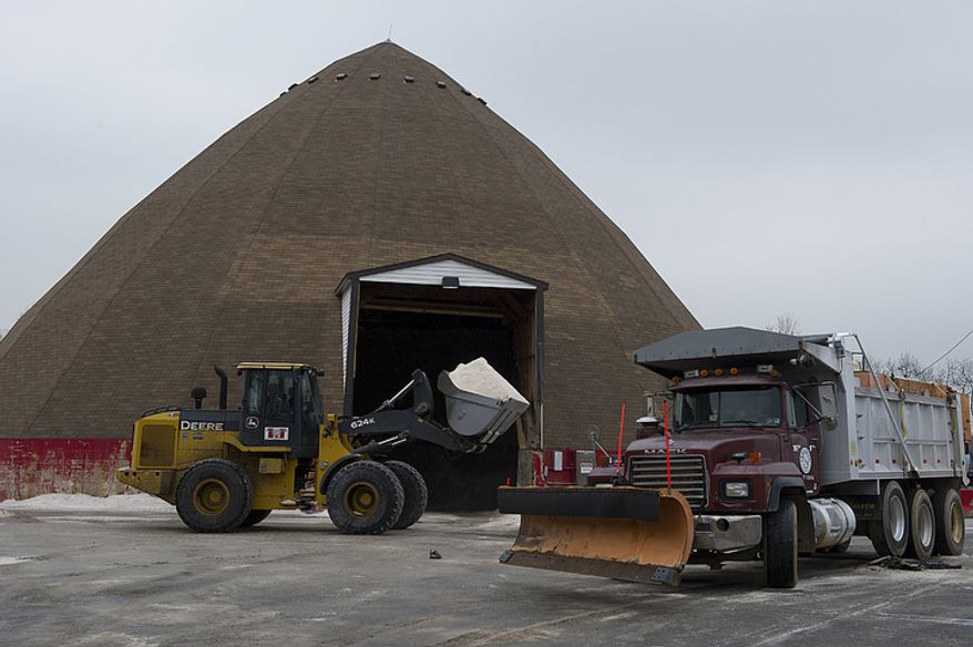 A snowplow is loaded with salt at the Virginia Department of Transportation's Van Dorn headquarters in Alexandria on Wednesday, Feb. 8, 2012, in anticipation of a wintry mix in the evening. The weather predictions call for possibly a dusting of snow in the Washington area, with up to 2 inches in outlying areas. (Barbara L. Salisbury/The Washington Times)