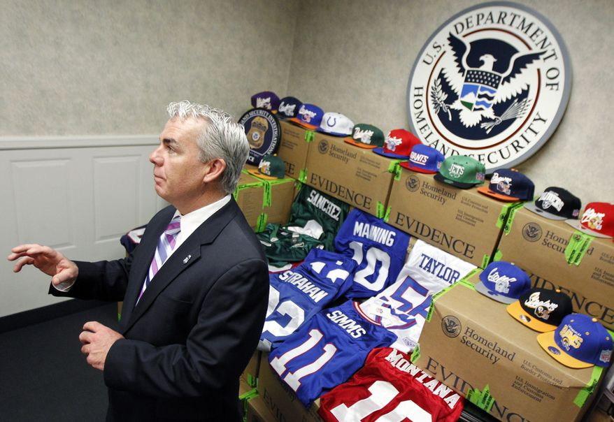 Andrew McLees, special agent in charge with the U.S. Department of Homeland Security, talks about counterfeit NFL football merchandise seized during a news conference, Thursday, Feb. 2, 2012, in Newark, N.J. Federal officials say authorities seized nearly $5 million worth of phony Super Bowl sportswear and merchandise in a nationwide sweep. (AP Photo/Julio Cortez)